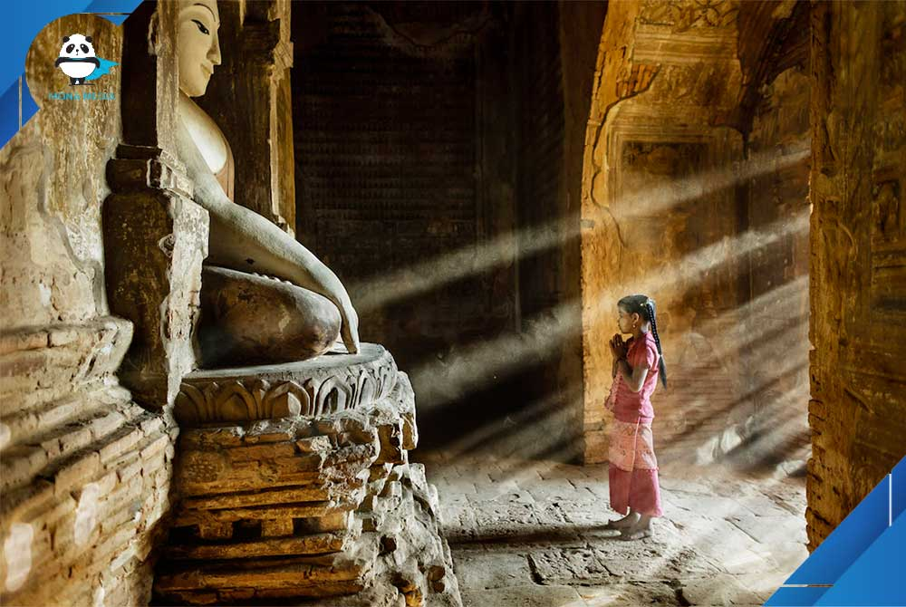 """Bagan, Myanmar. Stefano Pensotti, Italy. Overall winner, Travel Photographer of the Year 2018. """"Prayer time in one of little temples in the plain of Bagan—a young girl stops on her way to school."""" (Photo: Stefano Pensotti/www.tpoty.com)"""